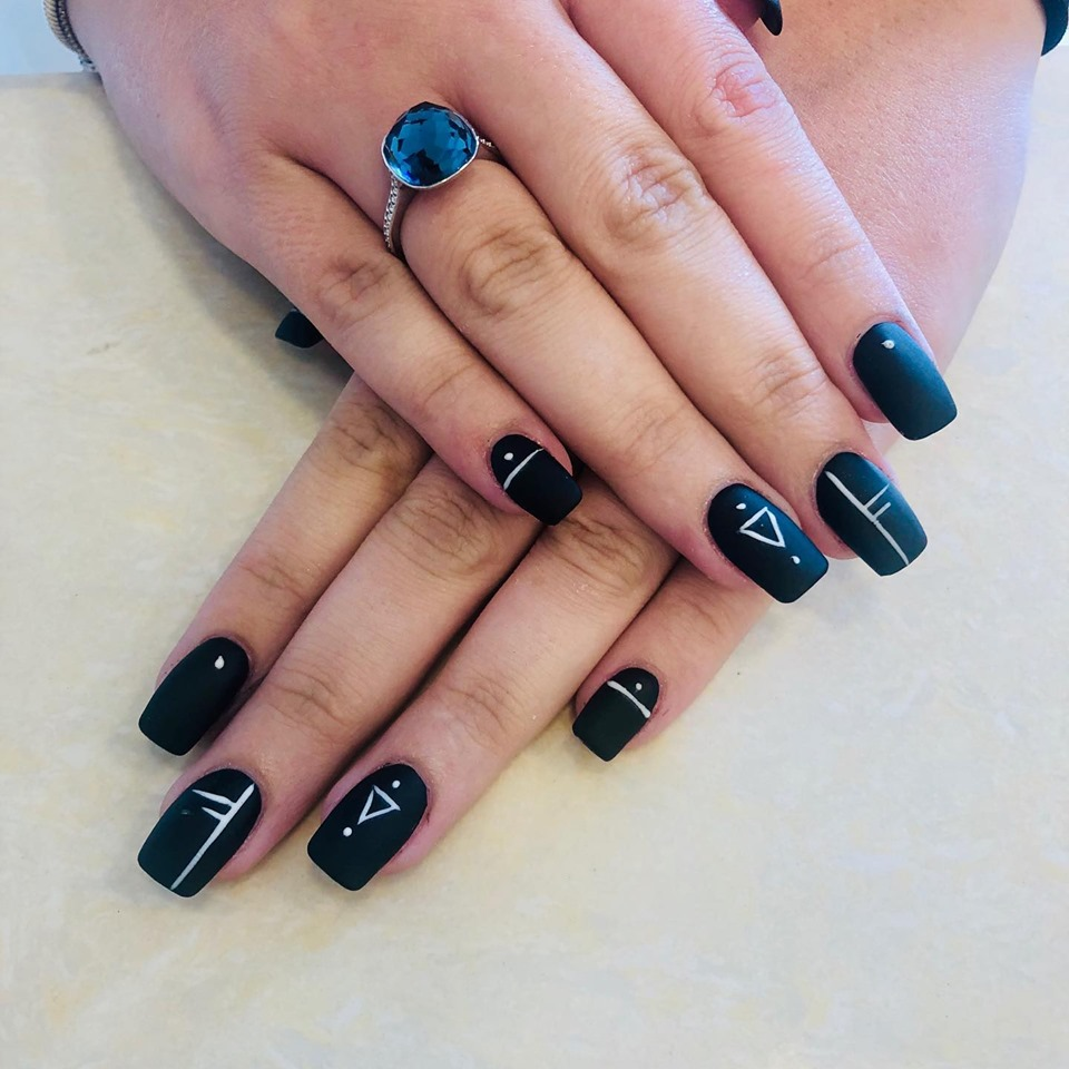 black nail extensions with hand designs